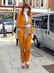 Florence opted for bold footwear, wearing leopard print sandals complete with wooden platform detailing.