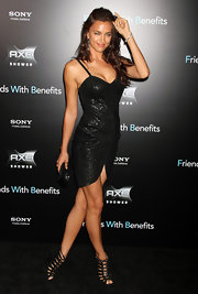 Irina Shayk added sizzle to her provocative LBD at the premiere of 'Friends With Benefits' with a pair of sultry black leather cage sandals.