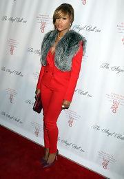 Eve did a bit of color blocking with this red pantsuit and purple pumps combo.