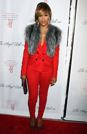 Eve donned a fur adorned blazer in a vibrant red hue with matching cigarette pants for the Angel Ball.
