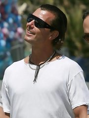Gavin rocked a slicked-back hairstyle with a pair of blacked-out designer shades.