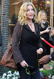 Shannon Tweed topped a ruffled blouse with a double-breasted vest for a TV guesting on 'Extra.'