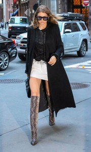 Gigi Hadid walked on the wild side in these chic knee-high snakeskin boots during a night out in New York City.