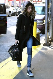 Gigi Hadid capped off her outfit with a black leather bowler bag by Karl Lagerfeld.