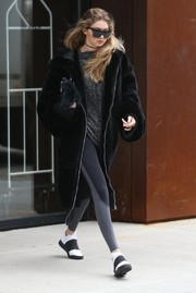 Gigi Hadid teamed two-tone leggings by Splits59 with a Fenty x Puma fur coat for a day out in New York City.