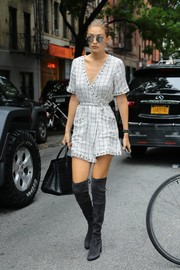 Gigi Hadid added oomph with a pair of gray over-the-knee boots by Stuart Weitzman.