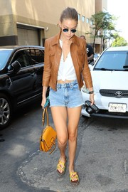 Gigi Hadid accessorized with a mustard Miu Miu satchel for a bright pop to her look.