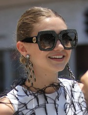 Gigi Hadid complemented her updo with a pair of statement chandelier earrings.