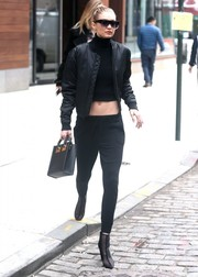Gigi Hadid added extra edge with a pair of black mesh ankle boots by Public Desire.