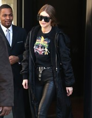 Gigi Hadid paired a grommeted Rockins belt with leather pants for an edgy look while out in New York City.