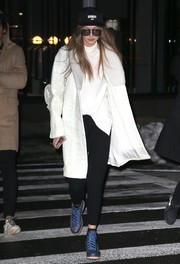 Gigi Hadid kept warm in luxurious style with a fur-lapel, croc-embossed leather coat while out and about in New York City.