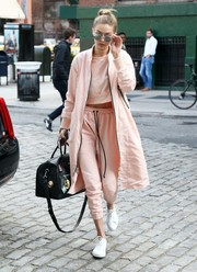 Gigi Hadid was spotted out in New York City looking sporty in pink jogging pants and a matching crop-top, both by Daniel Patrick.