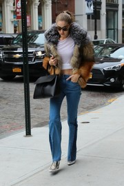 Gigi Hadid kept it casual on the bottom half in paneled bootcut jeans by Parker Smith.