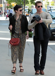 Ginnifer Goodwin stepped out in NYC wearing brown leather wedge sandals with her adorable patterned jumpsuit.