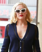 Gwen Stefani went for her signature retro beauty look to her acupuncture studio visit look by adding red lipstick.