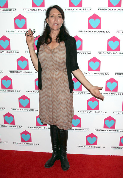 Katey Sagal matched a nude print dress with black knee-high boots for a feminine-meets-edgy look during the Friendly House LA luncheon.