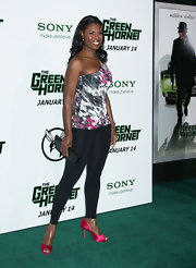 Omarosa added a dash of color to her premiere look with satin fuchsia peep toes.