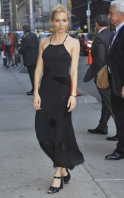 Sienna Miller looked effortlessly stylish in a black halter dress by Roland Mouret during her 'Stephen Colbert' appearance.