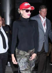 Gwen Stefani looked cool in a pair of top-heavy sunglasses while leaving a Samsung event.