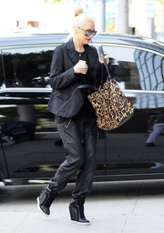 Gwen Stefani went for an athletic feel with a pair of black nylon sports pants.