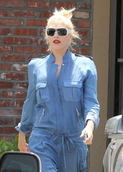 Gwen Stefani was spotted outside an acupuncture studio looking cool in white-rimmed designer shield sunglasses.