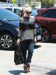 Gwen Stefani visited an acupuncture studio wearing a fun-looking arcade game sweater.