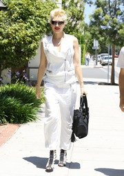 Wearing loose white pants with her zip-up top, Gwen Stefani made matchy-matchy look oh-so-cool.
