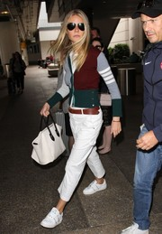 Gwyneth Paltrow kept it comfy all the way down to her white Valentino Rockstud leather sneakers.