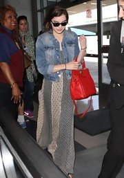 Hailee Steinfelt traveled in style when she wore this patchwork-style maxi dress while flying out of LA.
