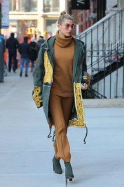 Hailey Baldwin was cozy and stylish in a tan turtleneck by LPA x Revolve while out in New York City.