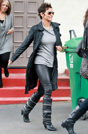Halle wears skinny leather pants with her black boots and trench.