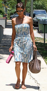 Halle Berry kept her cool in a strapless print dress, which she complemented with a slouchy taupe leather tote.