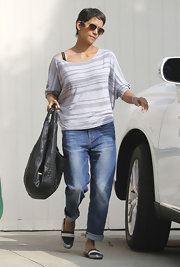Halle Berry headed to her car wearing a pair of tri-colored slip-on shoes.