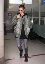 Heidi Klum kept her supermodel figure under wraps in a bulky bomber jacket by Facetasm as she arrived on a flight at LAX.