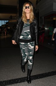 Heidi Klum was moto-chic in black boots, a camouflage track suit, and a leather jacket as she caught a flight out of LAX.