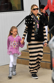 Heidi Klum hit the shops at The Grove in LA wearing a pair of black sneaker with her striped maxi dress.