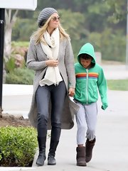 Heidi Klum sported a long gray cardigan and matching knit hat for a cozy and casual look while out with her son.