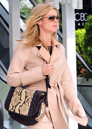 Heidi Klum runs errands carrying a studded python and leather shoulder bag.