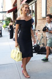 Heidi Klum stood out on the streets of New York City in a structured black off-the-shoulder dress by Roland Mouret.