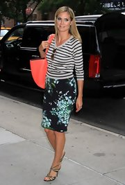 Heidi Klum chose a gray and blue striped top to pair with her floral pencil skirt for a fun mix of patterns.
