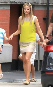 Heidi Klum rocked the color-blocked look when she sported this sleeveless tan and yellow shift dress.