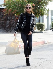 Heidi Klum cut a hip figure on the streets of West Hollywood wearing this embroidered leather jacket by Topshop.