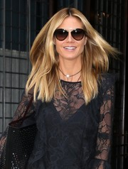 Heidi Klum geared up for a sunny day out with a pair of modern-chic shades.
