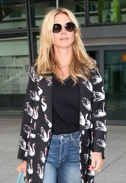 Heidi Klum stepped out of Heathrow wearing a pair of round sunnies.