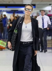 Heidi Klum looked hip in mirrored aviators while arriving on a flight at Miami International Airport.