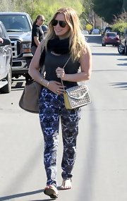Hilary Duff opted for a pair of silk print pants for her casual daytime look while out with her family in LA.