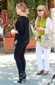 Hilary Duff dined out with her family in a pair of uber-cool buckled black leather Skyscraper Seditionary ankle boots.