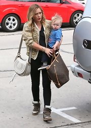 Hilary Duff was casual but trendy with a pair of suede and leather sneakers while out with her hubby and son.