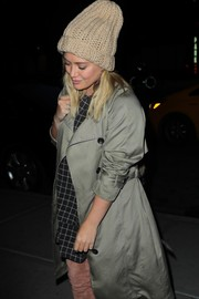 Hilary Duff kept warm with a beige knit beanie while enjoying a night out in New York City.