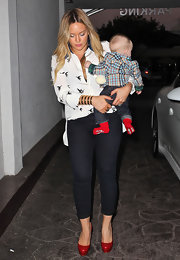 Hilary Duff wore bright red pumps with her white blouse and blue skinny jeans for bold pop of color.